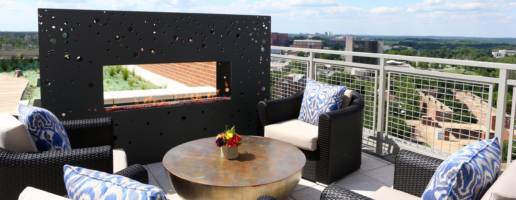 open rooftop fireplace with down town views